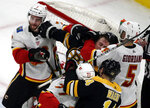 Boston Bruins center Noel Acciari, middle, grapples with Calgary Flames defensemen TJ Brodie, left, and Mark Giordano (5) in the third period of an NHL hockey game, Thursday, Jan. 3, 2019, in Boston. The Bruins won 6-4. (AP Photo/Elise Amendola)