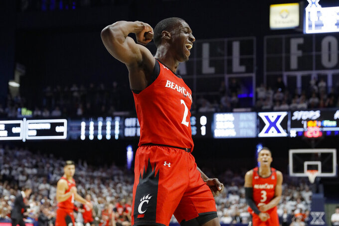 Cincinnati's Keith Williams reacts during the first half of an NCAA college basketball game against Xavier, Saturday, Dec. 7, 2019, in Cincinnati. (AP Photo/John Minchillo)