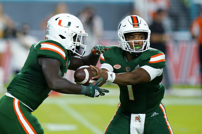Miami quarterback D'Eriq King (1) hands off to running back Donald Chaney Jr. during the first half of an NCAA college football game against Appalachian State, Saturday, Sept. 11, 2021, in Miami Gardens, Fla. (AP Photo/Wilfredo Lee)