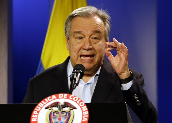 """FILE - Jan. 13, 2018 file photo, U.N. Secretary-General Antonio Guterres talks to the media during a join declaration with the Colombian president, in Bogota, Colombia. Saying humanity is waging war with the planet, the head of the United Nations isn't planning to let just any world leader speak about climate change in Monday's special """"action summit."""" Guterres says only those with new specific and bold plans can command the podium and the ever-warming world's attention.  (AP Photo/Fernando Vergara, File)"""