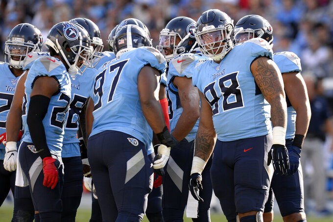 Tennessee Titans defensive lineman Jeffery Simmons (98) huddles with teammates in the first half of an NFL football game against the Los Angeles Chargers Sunday, Oct. 20, 2019, in Nashville, Tenn. The game is the first for the Titans' top draft pick. (AP Photo/Mark Zaleski)