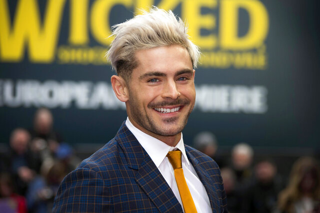 "FILE - In this Wednesday, April 24, 2019, file photo, actor Zac Efron poses for photographers upon arrival at a premiere in London. On his Twitter and Instagram accounts Sunday, Dec. 29, 2019, Efron said he has has ""bounced back"" after an illness while filming a show in Papua New Guinea. (Photo by Joel C Ryan/Invision/AP, File)"