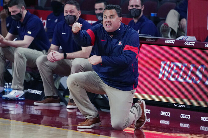 FILE - Arizona head coach Sean Miller gestures during an NCAA college basketball game against Southern California in Los Angeles, in this Saturday, Feb. 20, 2021, file photo. Arizona has parted ways with men's basketball coach Sean Miller as the program awaits its fate in an NCAA infractions investigation, a person with knowledge of the situation told The Associated Press. The person told the AP on condition of anonymity Wednesday, April 7, 2021, because no official announcement has been made. (AP Photo/Marcio Jose Sanchez, File)