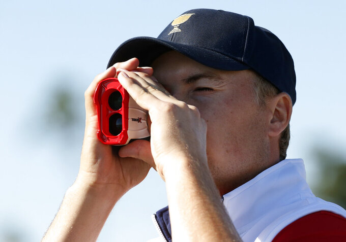 FILE - Jordan Spieth looks through a range finder following his four ball match at the Presidents Cup golf tournament at the Jack Nicklaus Golf Club Korea, in Incheon, South Korea, in this Friday, Oct. 9, 2015, file photo. Players will be allowed to use the measuring devices at the PGA Championship next week, the first time that's been allowed at a major. (AP Photo/Lee Jin-man, File)