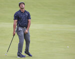 United States' Bryson DeChambeau reacts after missing a putt on the 128th green during the first round British Open Golf Championship at Royal St George's golf course Sandwich, England, Thursday, July 15, 2021. (AP Photo/Ian Walton)