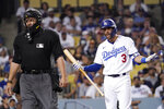 Los Angeles Dodgers' Chris Taylor, right, talks at home plate umpire Manny Gonzalez after striking out during the seventh inning of a baseball game against the Philadelphia Phillies Wednesday, June 16, 2021, in Los Angeles. (AP Photo/Mark J. Terrill)
