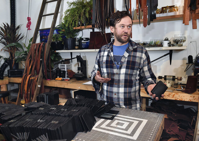 Michael Glick of Black Bear Leather, speaks from his work space about making wallets for members of the U.S. Congress on Friday, Oct. 30, 2020 in Lancaster, Pa. (Suzette Wenger/LNP/LancasterOnline via AP)