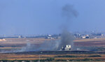 In this photo taken from the Turkish side of the border between Turkey and Syria, in Akcakale, Sanliurfa province, southeastern Turkey, smoke billows from a target inside Syria during bombardment by Turkish forces Wednesday, Oct. 9, 2019. Turkey launched a military operation Wednesday against Kurdish fighters in northeastern Syria after U.S. forces pulled back from the area, with a series of airstrikes hitting a town on Syria's northern border. (AP Photo/Lefteris Pitarakis)
