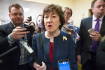 Sen. Susan Collins, R-Maine, is surrounded by reporters as she heads to vote at the Capitol in Washington, Wednesday, Nov. 6, 2019. (AP Photo/J. Scott Applewhite)