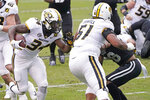 Missouri running back Larry Rountree III (34) follows the block of a Mississippi State defender by his offensive lineman Zeke Powell (51) on his way to a 18-yard touchdown run during the first half of an NCAA college football game, Saturday, Dec. 19, 2019, in Starkville, Miss. (AP Photo/Rogelio V. Solis)
