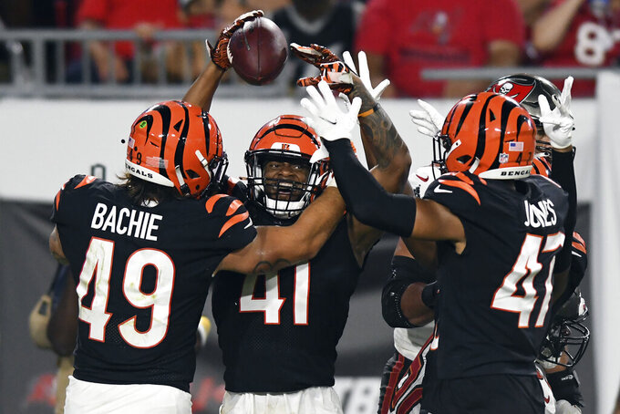 Cincinnati Bengals defensive back Trayvon Henderson (41) celebrates with linebacker Joe Bachie (49) after a play against the Tampa Bay Buccaneers during the second half of an NFL preseason football game Saturday, Aug. 14, 2021, in Tampa, Fla. (AP Photo/Jason Behnken)