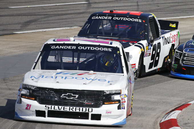 Sam Mayer (21) makes the turn in turn four during the NASCAR Truck Series race at Martinsville Speedway in Martinsville, Va., Saturday, Oct. 26, 2019, (AP Photo/Steve Helber)