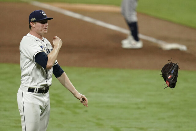 Tampa Bay Rays pitcher Peter Fairbanks celebrates their victory against the Houston Astros in Game 7 of a baseball American League Championship Series, Saturday, Oct. 17, 2020, in San Diego. The Rays defeated the Astros 4-2 to win the series 4-3 games. (AP Photo/Gregory Bull)
