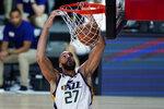 Utah Jazz's Rudy Gobert (27) dunks against the Oklahoma City Thunder during the second half of an NBA basketball game Saturday, Aug. 1, 2020, in Lake Buena Vista, Fla. (AP Photo/Ashley Landis, Pool)