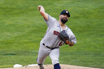 Houston Astros pitcher Jose Urquidy throws against the Minnesota Twins in the first inning of a baseball game, Friday, June 11, 2021, in Minneapolis. (AP Photo/Jim Mone)