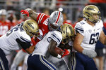 Ohio State defensive lineman Haskell Garrett, top, sacks Akron quarterback DJ Irons, center, during the first half of an NCAA college football game Saturday, Sept. 25, 2021, in Columbus, Ohio. (AP Photo/Jay LaPrete)