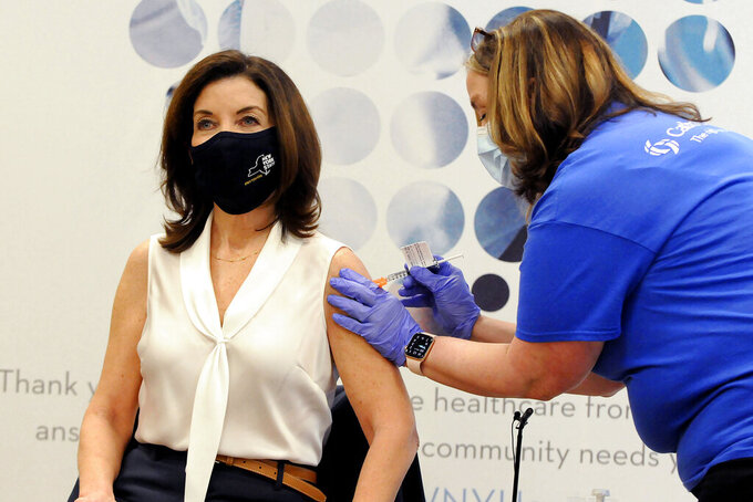 New York Lt. Gov. Kathy Hochul receives the Johnson & Johnson COVID-19 vaccine during a news conference, at Catholic Health in Buffalo, N.Y., Friday, March 12, 2021. (Don Heupel/Catholic Health via AP)