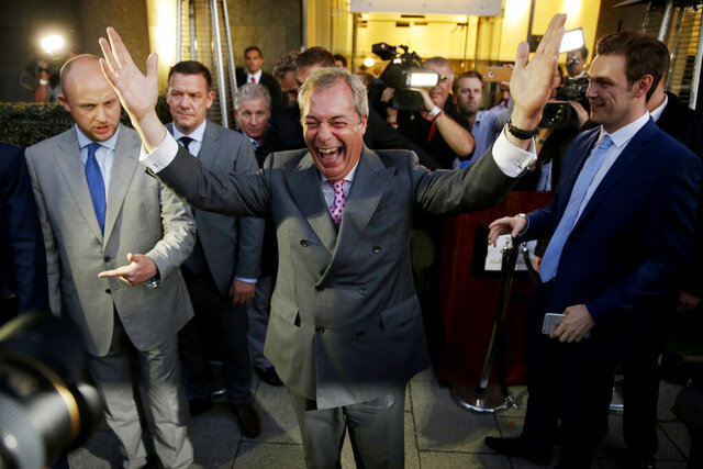 FILE - In this Friday, June 24, 2016 file photo, Nigel Farage, the leader of the UK Independence Party, celebrates after Britain voted to leave the European Union. Britain will finally leave the EU on Jan. 31, 2020 after 47 years of membership. (AP Photo/Matt Dunham, File)