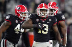 FILE - Georgia linebacker Azeez Ojulari (13) celebrates with his teammates after a sack during the second half of an NCAA college football game against Mississippi State in Athens, Ga., in this Saturday, Nov. 21, 2020, file photo. Ojulari is a possible first round pick in the NFL Draft, April 29-May 1, 2021, in Cleveland. (AP Photo/Brynn Anderson, File)