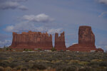 In this April 19, 2020, photo, homes and other structures are seen in Monument Valley, Ariz., on the Navajo reservation. Even before the pandemic, people living in rural communities and on reservations were among the toughest groups to count in the 2020 census. (AP Photo/Carolyn Kaster)