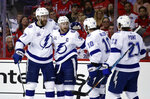 Tampa Bay Lightning defenseman Victor Hedman, left, from Sweden, center Steven Stamkos, center J.T. Miller and center Brayden Point celebrate Stamkos' goal with his teammates during the first period of Game 3 of the NHL Eastern Conference finals hockey playoff series against the Washington Capitals, Tuesday, May 15, 2018, in Washington. (AP Photo/Alex Brandon)