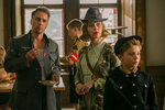 This image released by Fox Searchlight Pictures shows, from left, Sam Rockwell, Scarlett Johansson and Roman Griffin Davis in a scene from the WWII satirical film