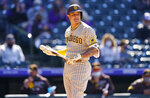 San Diego Padres' Manny Machado casts a glance at Colorado Rockies relief pitcher Mychal Givens after Machado struck out during the seventh inning of the first game of a baseball doubleheader Wednesday, May 12, 2021, in Denver. San Diego won 5-3. (AP Photo/David Zalubowski)