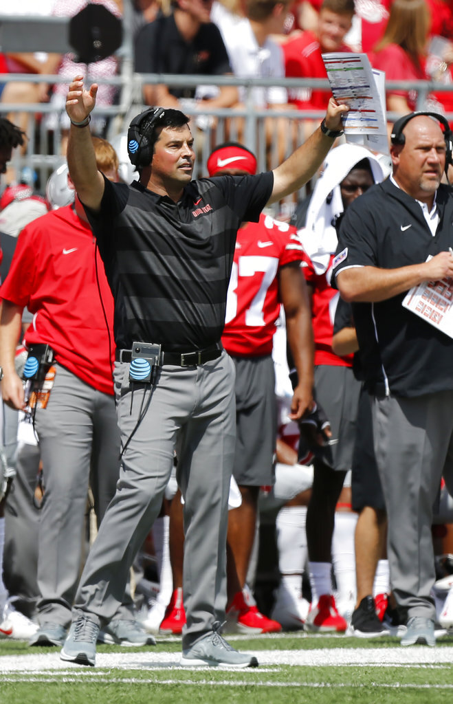 Ohio State acting head coach Ryan Day signals to his team against Oregon State during the first half of an NCAA college football game Saturday, Sept. 1, 2018, in Columbus, Ohio. (AP Photo/Jay LaPrete)