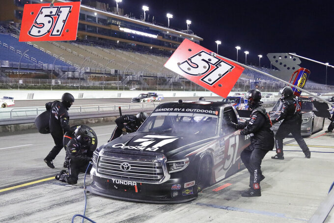 Kyle Busch (51) makes a pit stop during a NASCAR Truck Series auto race Saturday, June 13, 2020, in Homestead, Fla. (AP Photo/Wilfredo Lee)