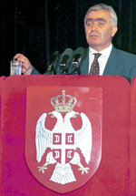 FILE - In this July 1997 file photo, Momcilo Krajisnik, Serb member of Bosnian Presidency addresses during Bosnian Serb Assembly session at Mt. Jahorina, near Sarajevo, Bosnia. The hospital in the northern Bosnian town of Banja Luka said Monday, Sept. 14, 2020, that Krajisnik, a former top wartime Bosnian Serb official who was convicted of war crimes by a U.N. court, died after contracting the new coronavirus. He was 75.  (AP Photo/Darko Vojinovic, File)