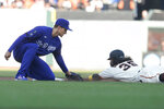 San Francisco Giants' Brandon Crawford, right, is tagged out while trying to steal second base by Los Angeles Dodgers' Corey Seager during the fifth inning of a baseball game in San Francisco, Sunday, Sept. 5, 2021. (AP Photo/Jeff Chiu)