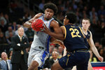 Duke center Vernon Carey Jr. (1) maneuvers around California forward Andre Kelly (22) during the first half of the first round of the 2K Empire Classic NCAA college basketball tournament, Thursday, Nov. 21, 2019, in New York. (AP Photo/Kathy Willens)