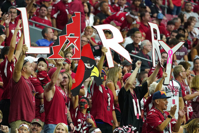 Arizona Cardinals fans cheer on Larry Fitzgerald during the second half of an NFL football game against the Detroit Lions, Sunday, Sept. 8, 2019, in Glendale, Ariz. (AP Photo/Rick Scuteri)