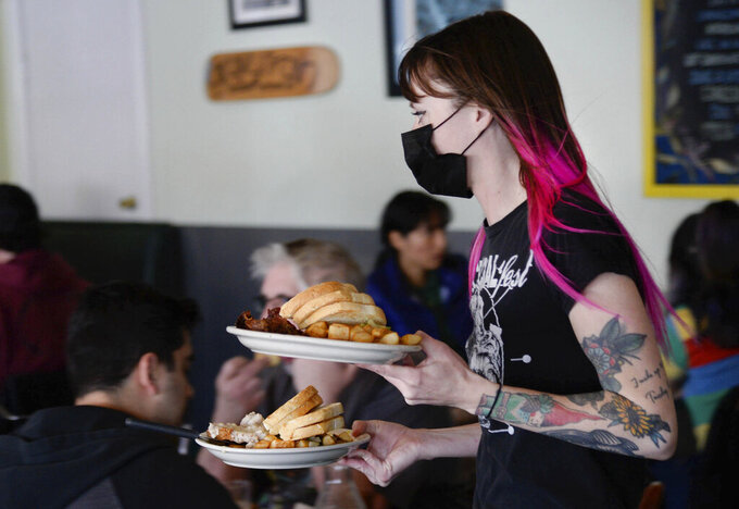 Leslie Powers delivers breakfast plates at Salt Lake City's Blue Plate Diner on Friday, March 12, 2021. The owners recently announced they will be closing on May 4, after 20 years in business. A new development is going in on the corner that is forcing it to shut down. (Francisco Kjolseth/The Salt Lake Tribune via AP)