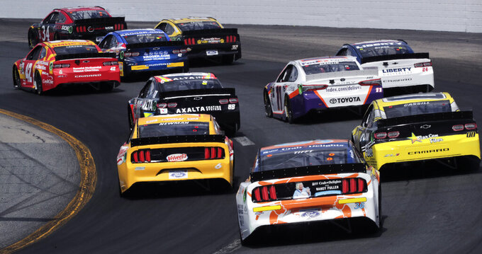 Racers head down the back straight during a NASCAR Cup Series auto race at New Hampshire Motor Speedway in Loudon, N.H., Sunday, July 21, 2019. (AP Photo/Charles Krupa)