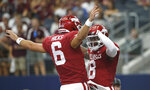 Arkansas quarterback Ben Hicks (6) and wide receiver Mike Woods (8) celebrate a touchdown pass against Texas A&M during the first half of an NCAA college football game Saturday, Sept. 28, 2019, in Arlington, Texas. (AP Photo/Ron Jenkins)