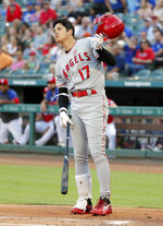 Los Angeles Angels' Shohei Ohtani watches the flight of his foul ball during an at-bat in the first inning of baseball game against the Texas Rangers in Arlington, Texas, Monday, Aug. 19, 2019. (AP Photo/Tony Gutierrez)