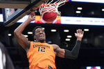 Oklahoma State forward Cameron McGriff dunks during the first half of an NCAA college basketball game against Mississippi in the final of the NIT Season Tip-Off tournament, Friday, Nov. 29, 2019, in New York. (AP Photo/Mary Altaffer)