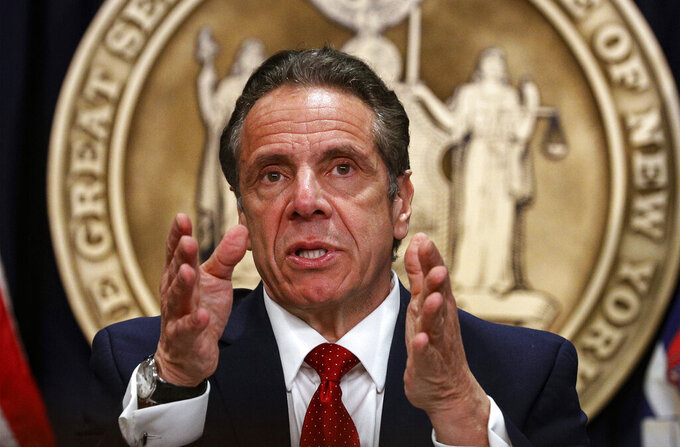 FILE - In this March 24, 2021 file photo, New York Gov. Andrew Cuomo speaks during a news conference at his offices in New York.  New Yorkers can now possess up to 3 ounces of cannabis under a legalization bill signed by Cuomo. Criminal justice reform advocates hope the legislation signed Wednesday, March 31,  will help redress the inequities of a system that has locked up people of color for marijuana offenses at disproportionate rates.  (Brendan McDermid/Pool Photo via AP, File)