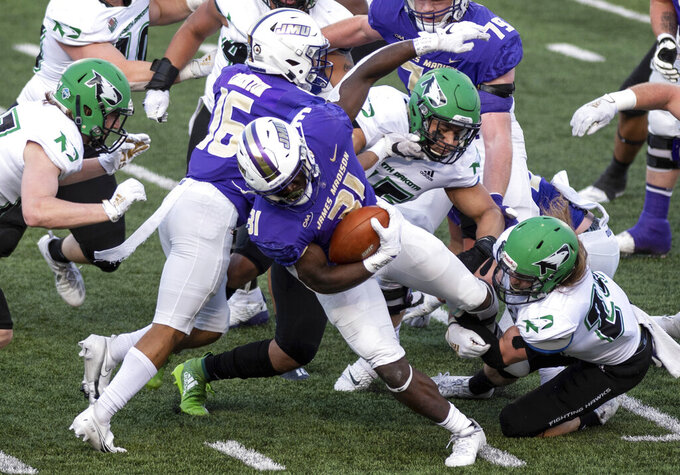 James Madison running back Percy Agyei-Obese (31) bursts out of traffic during the first half of a quarterfinal game against North Dakota in the NCAA FCS football playoffs in Harrisonburg, Va., Sunday, May 2, 2021. (Daniel Lin/Daily News-Record via AP)
