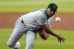 Miami Marlins starting pitcher Sixto Sanchez works against the Atlanta Braves in the first inning of a baseball game Wednesday, Sept. 23, 2020, in Atlanta. (AP Photo/John Bazemore)