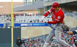 Los Angeles Angels' Shohei Ohtani, of Japan, swings at an incoming pitch for a two-run home run off Minnesota Twins pitcher Jose Berrios in the third inning of a baseball game Monday, May 13, 2019, in Minneapolis. (AP Photo/Jim Mone)