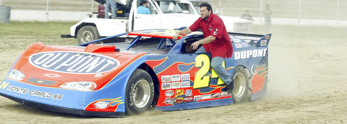 FILE - NASCAR driver Tony Stewart takes a ride on Jeff Gordon's race car in the pit during the Nextel Prelude to the Dream at Eldora Speedway in Rossburg, Ohio, in this Wednesday, June 6, 2007, file photo. Tony Stewart wants to set the record straight about two misconstrued recent business decisions. Fans have been critical of Stewart since the Truck Series was dropped from Eldora Speedway and because he didn't sign Kyle Larson to his NASCAR team. Stewart is adamant that he tried to sign Larson but couldn't get partner approval on the driver suspended for using a racial slur. And he insists he dropped NASCAR after he felt slighted that Bristol Motor Speedway was given a Cup race on dirt. (Teesha McClam/Dayton Daily News via AP, File)