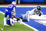 Seattle Seahawks' DK Metcalf (14) dives past Buffalo Bills' Dane Jackson (30) for a touchdown during the second half of an NFL football game Sunday, Nov. 8, 2020, in Orchard Park, N.Y. (AP Photo/John Munson)