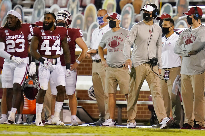 Oklahoma head coach Lincoln Riley walks on the sideline n the second half of an NCAA college football game against Missouri State, Saturday, Sept. 12, 2020, in Norman, Okla. (AP Photo/Sue Ogrocki, Pool)
