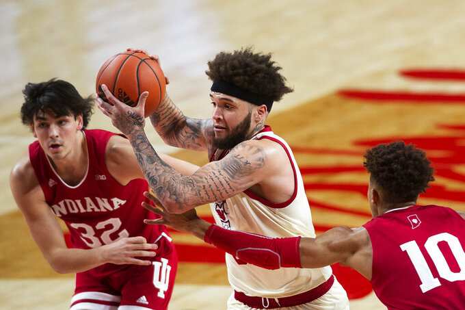Nebraska's Teddy Allen, center, drives to the basket while guarded by Indiana's Trey Galloway and Rob Phinisee in the first half of an NCAA college basketball game on Sunday, Jan. 10, 2021. (Kenneth Ferriera/Lincoln Journal Star via AP)