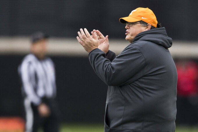 In this Thursday, March 7, 2019 photo, Tennessee offensive coordinator Jim Chaney instructs his players during Vol's opening spring NCAA college football practice in Knoxville, Tenn. Tennessee is opening spring practice with its fourth offensive coordinator in as many seasons as it tries to rejuvenate an attack that ranked last in the Southeastern Conference in yards per game the last two years. (Caitie McMekin/Knoxville News Sentinel via AP)