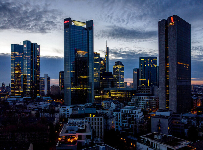 Lights burn in some offices of the buildings of the banking district in Frankfurt, Germany, Monday, March 29, 2021. (AP Photo/Michael Probst)