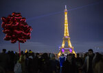 A light show illuminates the Eiffel Tower to mark Valentine's day, in Paris, in Paris, Friday, Feb. 14, 2020. Valentine's Day is observed on February 14 each year as a special day to celebrate love and romance. (AP Photo/Rafael Yaghobzadeh)