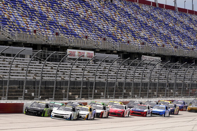 Cars move after the second re-start during a NASCAR Xfinity Series auto race Saturday, Sept. 5, 2020, in Darlington, S.C. (AP Photo/Chris Carlson)